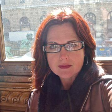 Image of Professor Colleen Kiely in front of window.