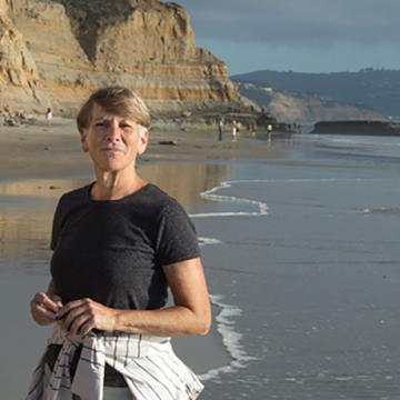 Image of Professor Edie Bresler on a beach.
