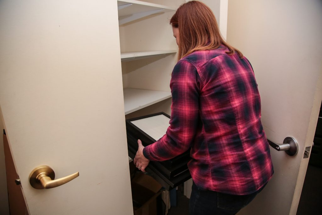 Picture of Courtney Dee cleaning out a closet