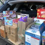 picture of food and supplies in a trunk