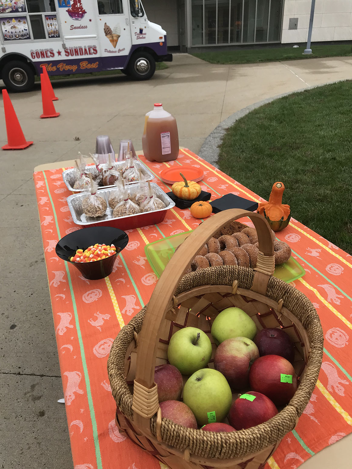 Fall treats, apples, candy corn on table