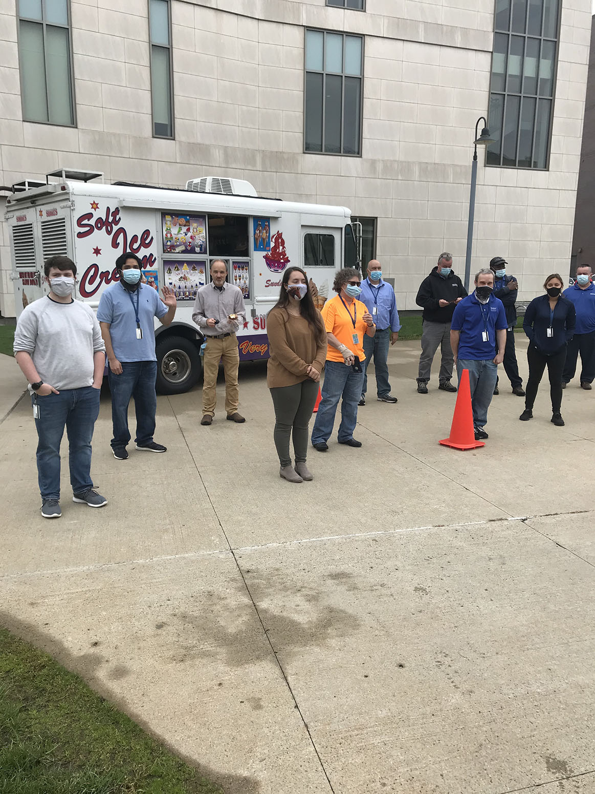 Employees standing in front of ice cream truck